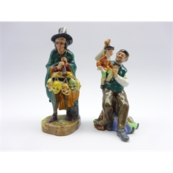 Royal Doulton figures 'The Puppetmaker' HN2253 and 'The Mask Seller' HN2103 (2)