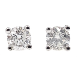 Pair of 18ct white gold diamond stud earrings, stamped 750, diamonds total 0.4 carat