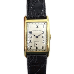 International Watch Co 14ct gold 'curvex' wristwatch, c.1929, silvered dial, the hinged back case numbered 324192, on leather strap