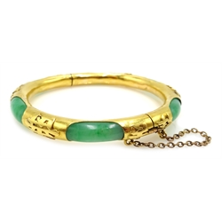 19th century Chinese gold and jade hinged bangle, with character marks embossed around the gold exterior, stamped 22 PG
