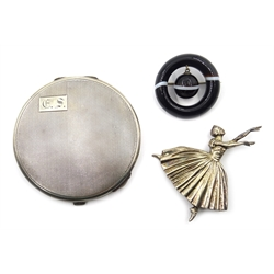 Silver engine turned compact by Barker Brothers Silver Ltd, Birmingham 1938, silver ballerina brooch by D H Phillips Ltd, Birmingham and an agate circular and suspended ball brooch (3)