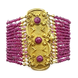 Fourteen row fine garnet bead bracelet, with a heavy 18ct gold clasp, stamped 750 made and retailed by Leonard, Sorrento, Italy, in original box