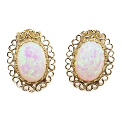 Pair of 9ct gold opal filigree stud earrings, stamped 375
