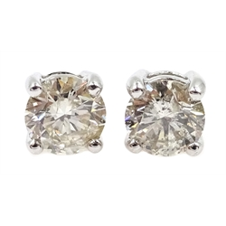 Pair of 18ct white gold diamond stud earrings, stamped 750, diamonds approx 1.04 carat