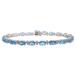 18ct white gold blue topaz and diamond bracelet, stamped 750, topaz approx 12 carat, diamonds approx 0.8 carat