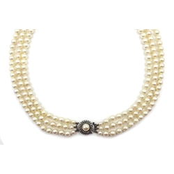 Three strand cultured pearl necklace, with silver marcasite and pearl clasp, hallmarked