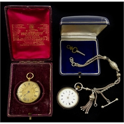 18ct gold ladies pocket watch, key wound, stamped 'FM 18K', engraved 'Orr & Co Bangalore' and a silver ladies pocket watch, London import marks 1908 on fancy link chain