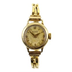 Rodania 9ct gold wristwatch, hallmarked, on gold expandable strap, stamped 18ct