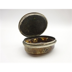 19th Century Continental moss agate oval snuff box, the hinged silver cover embossed in low relief with figures feasting 6cm x 5cm