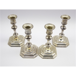 Set of four Georgian design silver candlesticks, 1 pair London 1904 and the others 1899 and 1900 H18cm Maker Thomas Bradbury & Sons