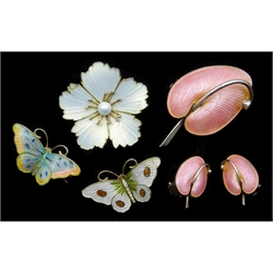 Mid 20th century Danish silver pink enamel lily brooch and matching clip on earrings by Volmer Bahner & Co, Copenhagen, similar daisy brooch by Viggo Pedersen and two Norwegian butterfly broochs by Hroar Prydz, all stamped