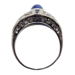Platinum (tested) ring set with a central cabochon sapphire and calibre cut sapphires and diamond surround