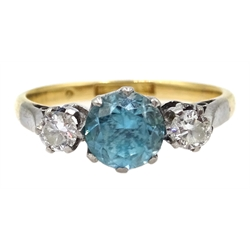Three stone diamond and blue zircon gold ring, stamped 18ct & Plat