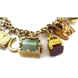 Gold curb chain bracelet, stamped 9 375, with two full sovereigns dated 1908 and 1912, thirteen 9ct gold charms, hallmarked and a gold mounted carnelian fob