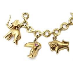 Gold bracelet with seven Hans Georg Mautner gold animal charms, set with ruby and sapphire cabochon eyes, all hallmarked 9ct, monkey and cat charms, tested 9ct and coral Buddha charm
