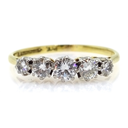 Gold five stone graduating diamond ring, stamped 18