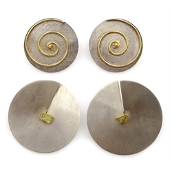 Pair of Greek silver and 18ct gold, spinning swirl circular stud earrings, stamped 925, with certificate and pair of silver and gold circular stud earrings, makers mark J H, London 1990