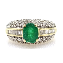 Gold oval emerald ring, with baguette and round brilliant cut diamond shoulders, stamped 14K, retailed by Zales