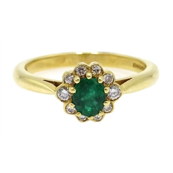 18ct gold oval emerald and diamond cluster ring, hallmarked
