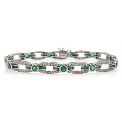 White gold round and calibre cut emerald and round brilliant cut diamond link bracelet, stamped K18
