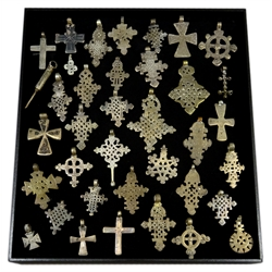 Thirty five Ethiopian Coptic and Latin cross pendants and two others, silver coloured metal