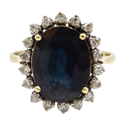 Gold oval sapphire and diamond cluster ring, stamped 14K