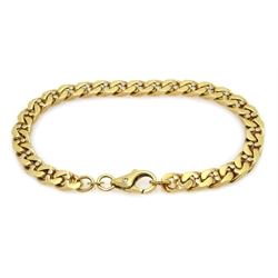 Gold flattened curb bracelet, the clasp set with a single stone, stamped 14K