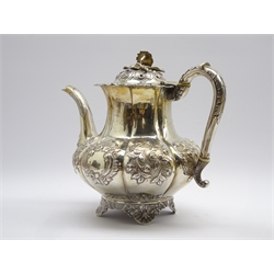 William IV silver teapot with embossed floral decoration, bud lift and leaf capped handle London 1830 Maker possibly William Hewitt 29.9oz