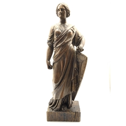 Victorian carved wood standing female figure, classically draped and with a shield on rectangular base H86cm