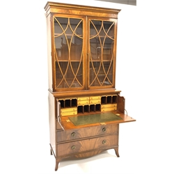 George III style mahogany secretaire bookcase, moulded cornice above plain frieze, astragal glazed doors enclosing two adjustable shelves, panelled f