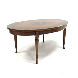 Regency design mahogany coffee occasional table of oval form, with floral painted panel, raised on turned splayed supports, 106cm x 66cm, H45cm