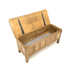 'Mouseman' Yorkshire oak panelled blanket chest, with adzed rectangular hinged top, raised on octagonal supports, with mouse signature, 105cm x 40cm, D47cm