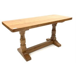 'Mouseman' adzed Yorkshire oak coffee table, rectangular top raised on octagonal supports with sledge feet, united by floor stretcher, 91cm x 38cm, H45cm