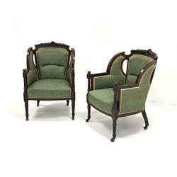 Pair late Victorian walnut framed armchairs upholstered in green damask fabric, gadroon and floral carved cresting rail, turned fluted front supports raised on brass castors, W59cm, H86cm, D66cm