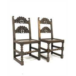 Near pair of early 18th century Derbyshire oak country chair, with scroll carved back, panelled seat, bobbin turned front supports and stretcher, W47
