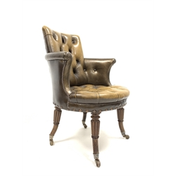 19th century mahogany framed library chair upholstered in deep buttoned brown leather, raised on out swept turned tapered and reeded supports, terminating in ceramic castors, attributed to Gillows, W72cm