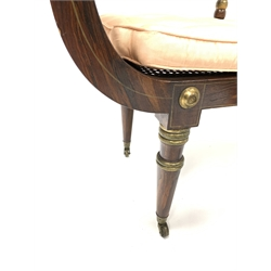 Pair of small 20th century Regency design simulated rosewood chaise lounges, scrolled rope twist cresting rail above red and white stripe upholstered back panel, bergseat panel covered with silk upholstered squab cushions, turned supports terminating in brass cup castors, W113cm, H88cm, D45cm