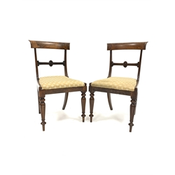 Pair of William IV rosewood dining chairs, floral carved and scrolled bar back, drop in upholstered seat pad, turned and fluted tapering front suppor