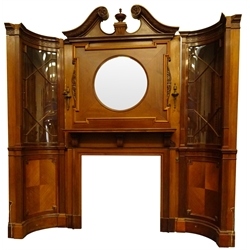 Large Edwardian Adam style mahogany chimney-piece, fire-surround with swan neck pediment and urn finial above circular bevelled mirror plate with two