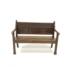 19th century oak hall settle, with relief carved floral frieze above panelled back, chequered band inlay and square supports and block feet, W126cm