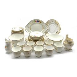 19th century porcelain tea set for six decorated with acorn gilding and another 19th century tea set hand painted with fruit