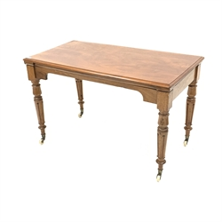 19th century walnut library side table, the associated moulded top raised on turned fluted supports terminating in ceramic castors, 122cm x 65cm, H75