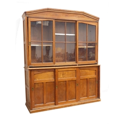 WITHDRAWN - Victorian pitch pine bookcase display cabinet, top section enclosed by three sliding astragal glazed doors, bottom section enclosed by th