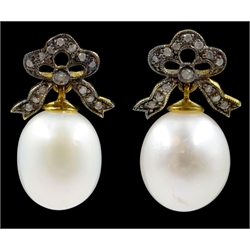 Pair of pearl and diamond bow pendant earrings