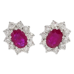 Pair of 18ct white gold ruby and dimaond cluster stud earrings, total ruby weight 1.9 carat, total diamond weight 1 carat