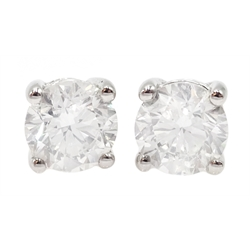 Pair of 18ct white gold diamond stud earrings stamped 750, diamond total weight 2.43 carat