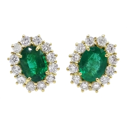 Pair of 18ct gold Zambian emerald and diamond cluster stud earrings, stamped 750, each emerald approx 1 carat
