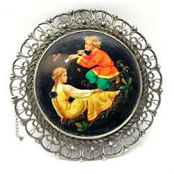 Russian papier mache circular brooch decorated with Fairytale scene, titled and inscribed verso, in white metal openwork mount D6.5cm