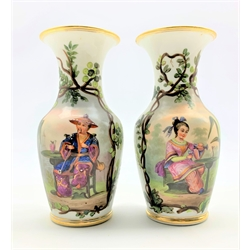 Pair of 19th Century Paris porcelain vases painted with seated male and female Chinese figures within foliage with gilt rim and foot H22cm