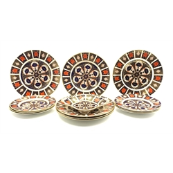 Six Royal Crown Derby dinner plates, six side plates and a bon bon dish, all in the Imari pattern 1128